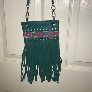 turquoise across the body purse!